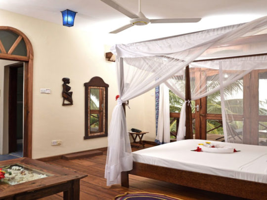 Penthouse-bedroom-at-Mnarani-Beach-Cottages-Hotel-in-Nungwi-Zanzibar